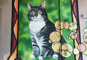 Room 8 the Cat mural at Elysian Heights Elementary | Instagram by @budgetfabulous